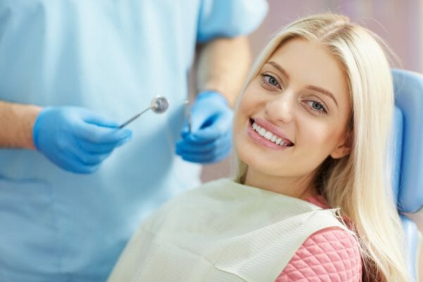 Woman sitting in dentist chair getting root canal